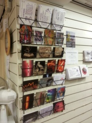 Alban Low and postcard display at Oxfam