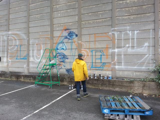 Jadryk Brown paints the Plurabelle Mural