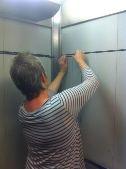 Rachel Wooller installs in the lift at Waterstones