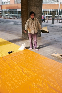 A visitor to the ALL Day of Performances stands by Elisa Vladilo's tarpaulin 'Rhyme of Origin' at the CU Sidgwick Site